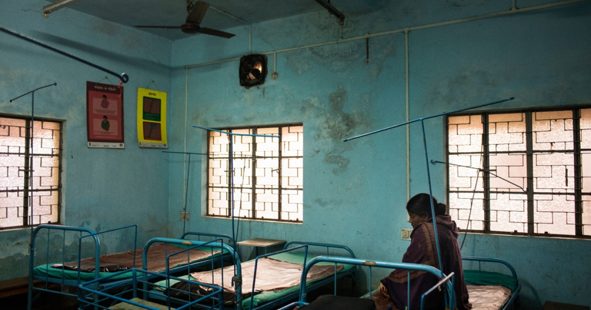 A pregnant woman waits for delivery at the primary health center in Borsul village, West Bengal. Primary health centers typically provide basic health care services as well as antenatal and postnatal care for women.</p>