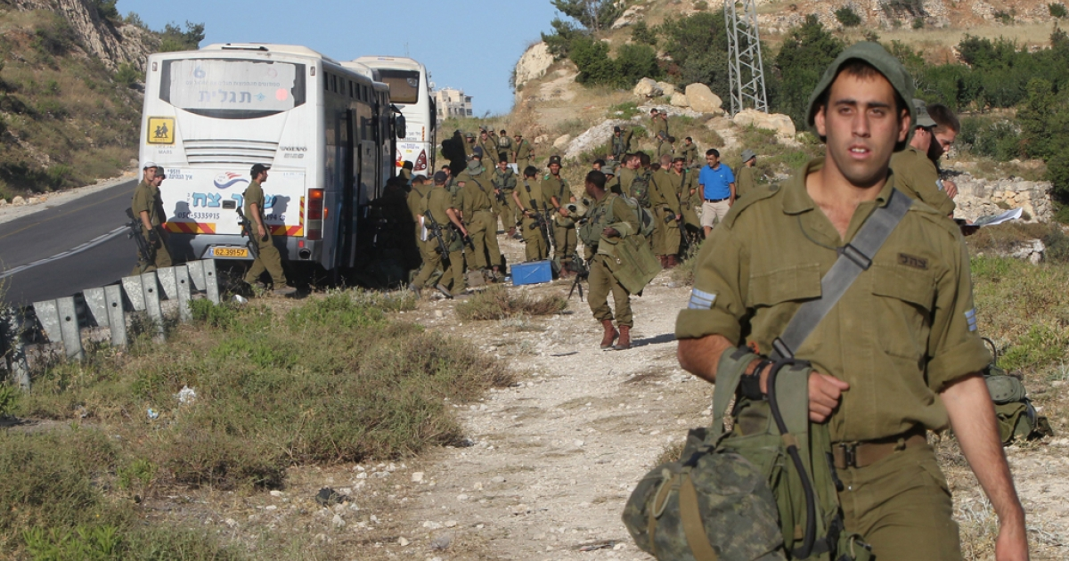 Israeli army troops in the area between the West Bank village of Halhul and Hebron on June 24,2014 as the search for the missing Israeli teens continues.</p>