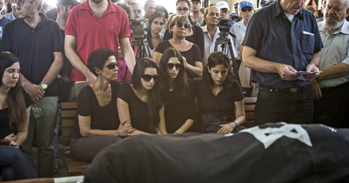 Relatives and family members mourn during the funeral for Emanuel and Miriam Riva, who were killed in the shooting attack at the Brussels Jewish Museum this past Saturday, on May 27, 2014 in Tel Aviv, Israel.</p>