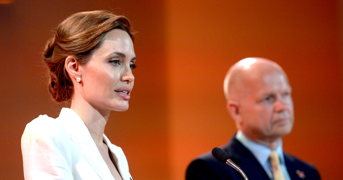 UN special envoy Angelina Jolie makes the opening speech with co-host Britain's Foreign Secretary William Hague at the start of the four-day Global Summit to End Sexual Violence in Conflict on June 10, 2014 in London, England.</p>