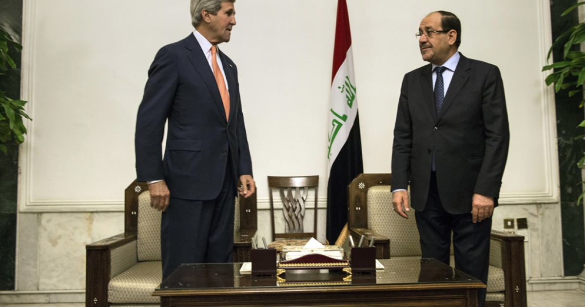 Iraqi Prime Minister Nouri al-Maliki (R) and US Secretary of State John Kerry meet at the Prime Minister's Office in Baghdad on June 23, 2014.</p>