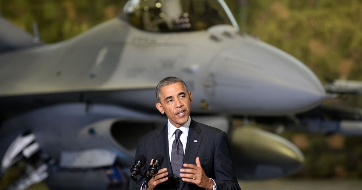US President Barack Obama addresses US and Polish airmen in front of a F-16 fighter jet at Warsaw Chopin Airport, Poland, on June 3, 2014.</p>