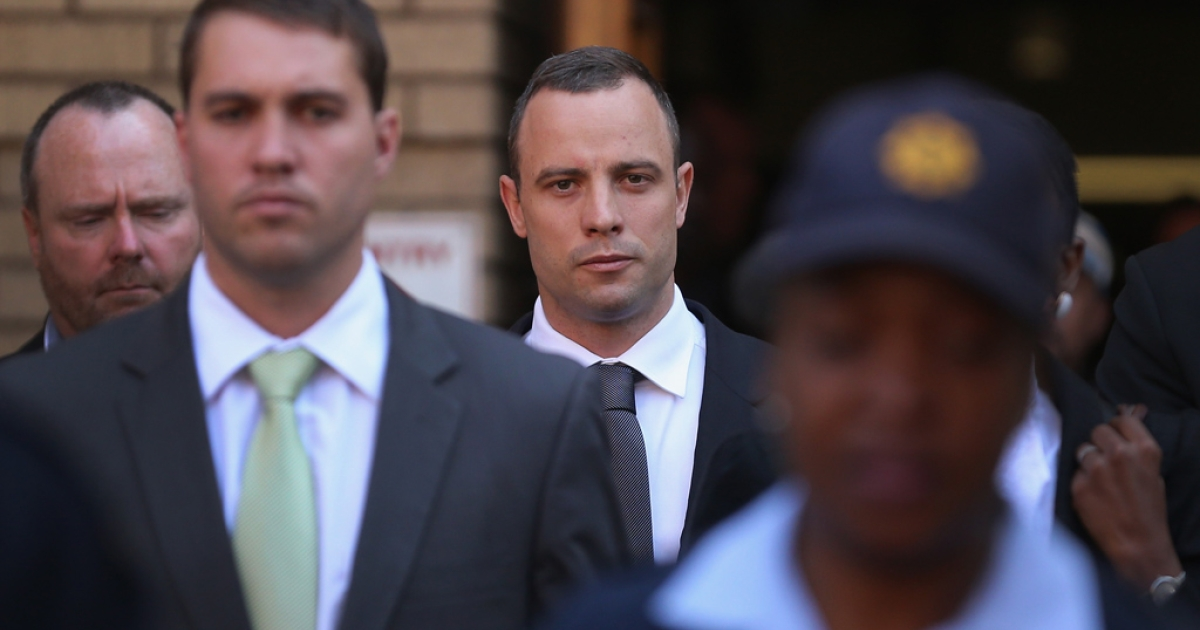 Oscar Pistorius leaves North Gauteng High Court after the judge ordered that he should undergo mental evaluation on May 14, 2014 in Pretoria, South Africa.</p>