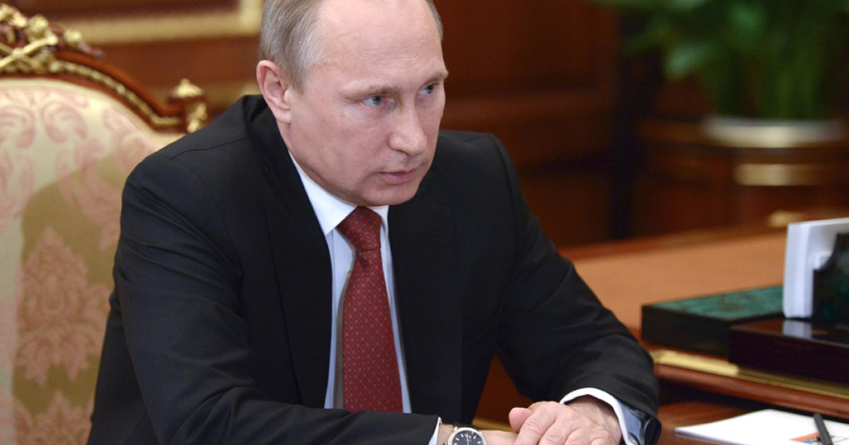 Russia's President Vladimir Putin attends a meeting in the Kremlin in Moscow, on June 20, 2014.</p>