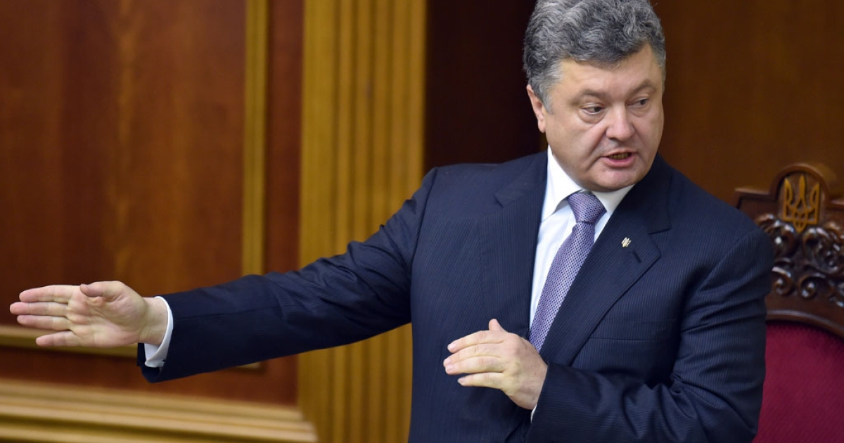 Ukrainian President Petro Poroshenko gestures as he speaks to parliament members prior to their vote to approve senior official appointments in Kyiv on June 19, 2014.</p>