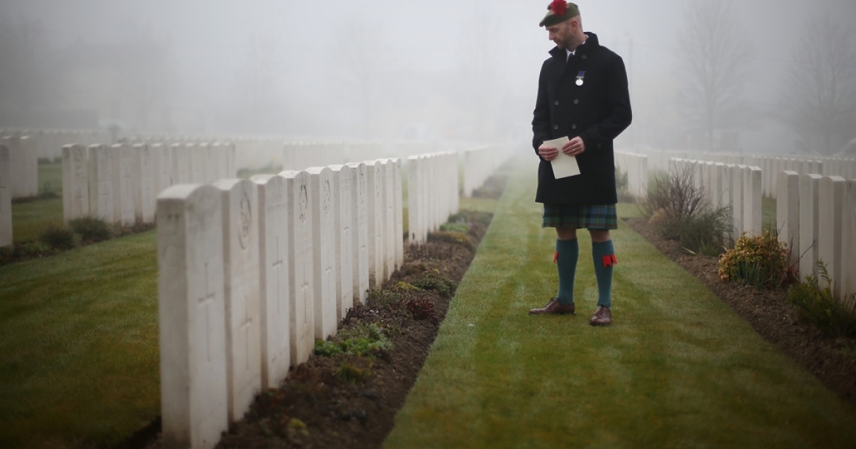 Stephen McLeod, great step nephew of a WWI soldier, looks at headstones before a reburial ceremony at Loos British Cemetery in March in Loos-en-Gohelle, France.</p>