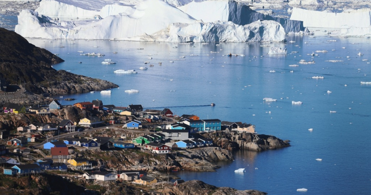 A view from the village of Ilulissat, Greenland of icebergs that broke off from the Jakobshavn Glacier on July 24, 2013. As the sea levels around the globe rise, researchers affiliated with the National Science Foundation and other organizations are studying the melting glaciers and long-term ramifications.</p>