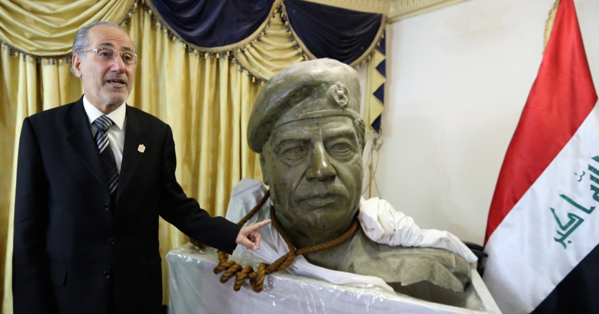 The bust of former Iraqi leader Saddam Hussein and the actual rope used to hang him, on display in the living room of former national security adviser Mowaffak al-Rubaie, during an AFP interview in December, 2013.</p>