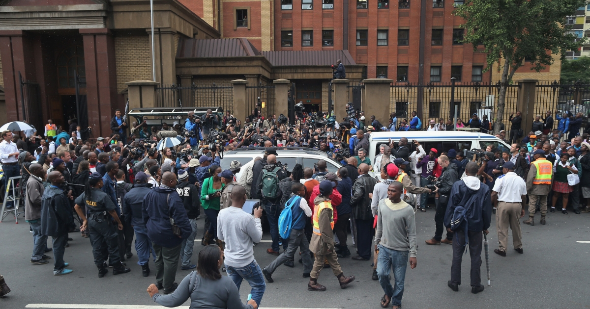 Oscar Pistorius leaves North Gauteng High Court amid a media scrum after the second day of his trial accused of the murder of his girlfriend Reeva Steenkamp.</p>