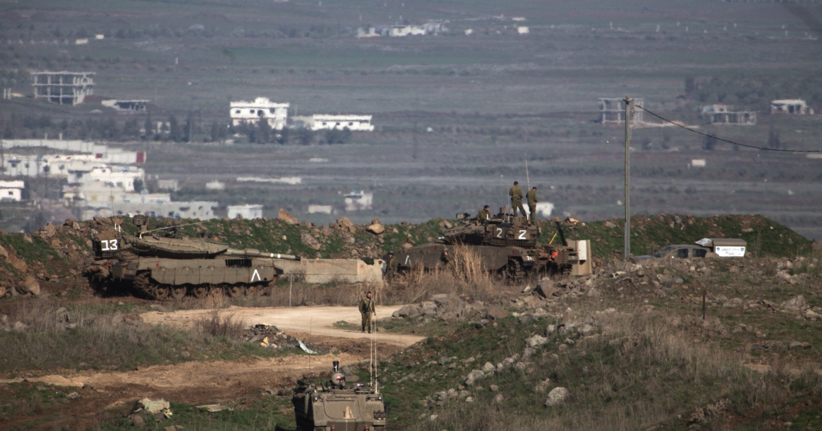 Israeli tanks and soldiers are stationed over looking Syria along the Israel-Syria border in the Israel-occupied Golan Heights, on March 5 2014. Israel's army said it struck two Hezbollah fighters as they were planting a bomb near the Israeli-Syrian frontier.</p>