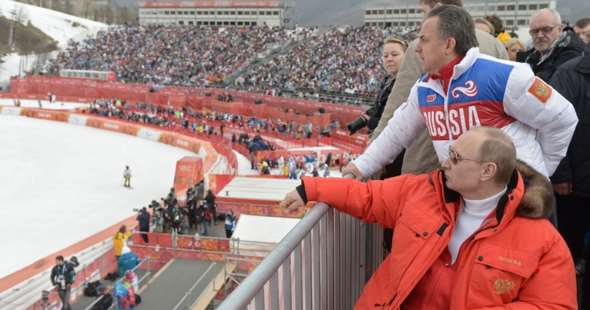 Russian President Vladimir Putin watches a men's Alpine skiing event at the Sochi 2014 Winter Paralympics on March 9, 2014.</p>