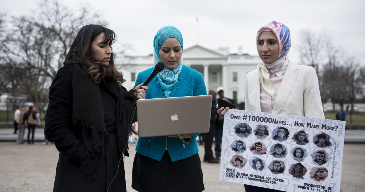 Activists read names of people killed in Syria outside the White House March 12, 2014 in Washington, DC, part of a three-day vigil where they will read the names of over 100,000 people who have died in Syria during the last three years of civil war.</p>