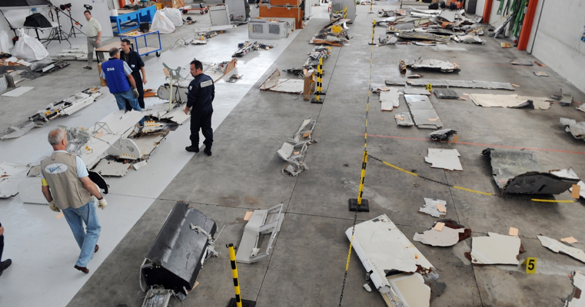 Investigators inspect debris from the mid-Atlantic crash of Air France Flight 447 on July 24, 2009, at the CEAT aeronautical laboratory in Toulouse, southern France.</p>