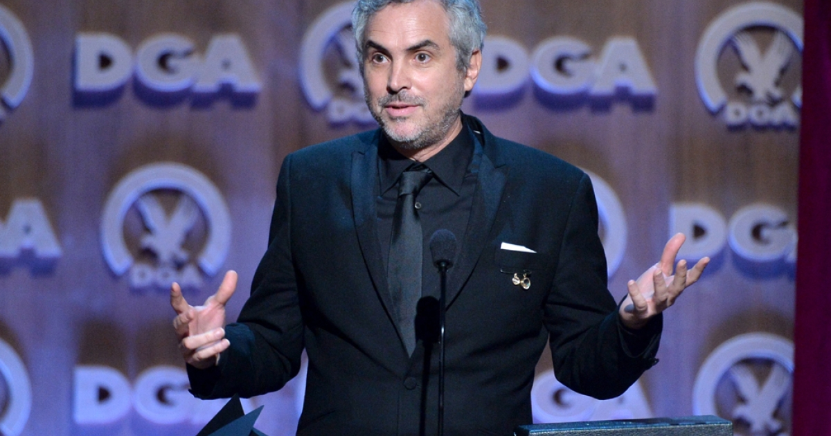 "Alfonso Cuaron accepts the Outstanding Directorial Achievement Award for ""Gravity"" at the 66th annual Directors Guild Of America Awards on Jan. 25, 2014 in Century City, Calif.</p>"