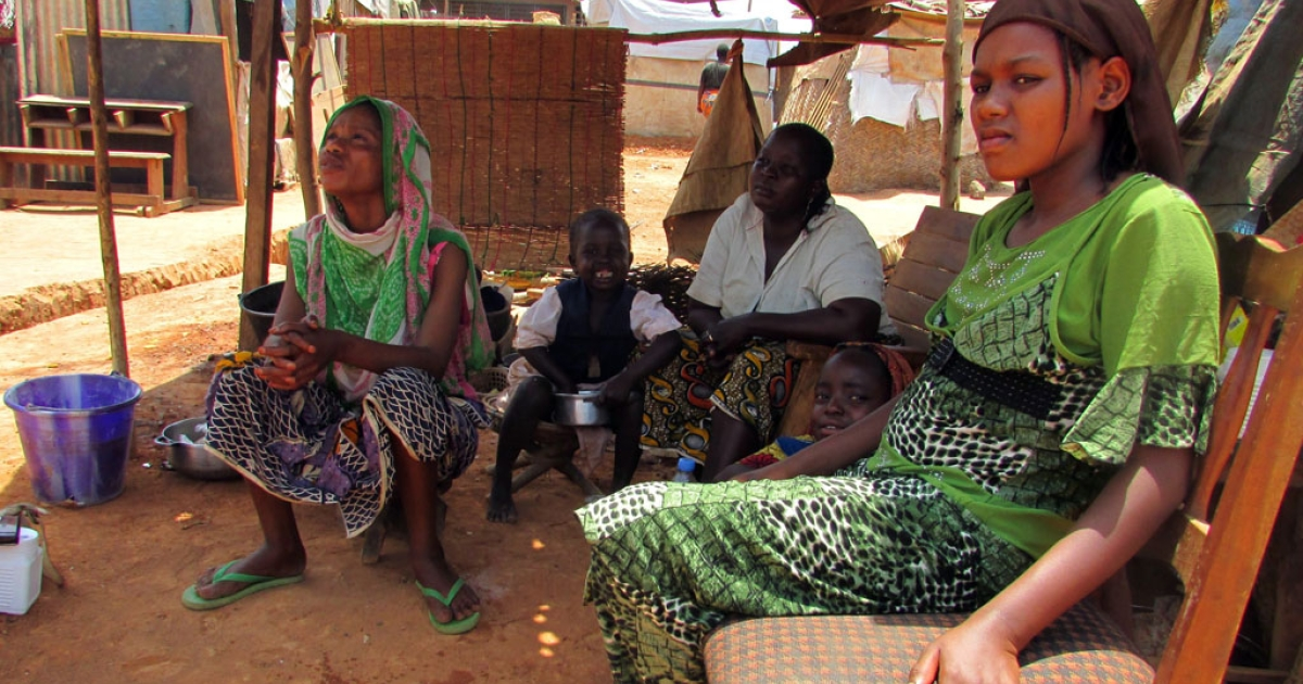 Displaced people sit at a refugee camp in Bossangoa, Central African Republic, on March 19, 2014.</p>
