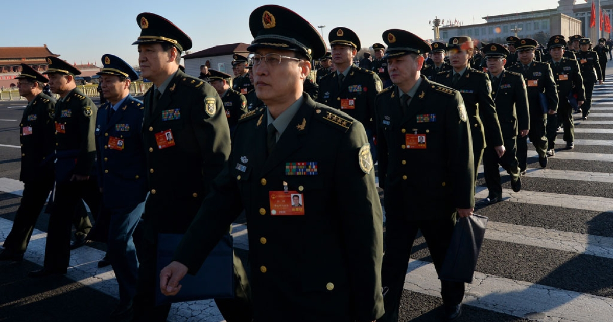 Military delegates arrive for the first session of the National People's Congress (NPC) at the Great Hall of the People in Beijing on March 5, 2014.</p>