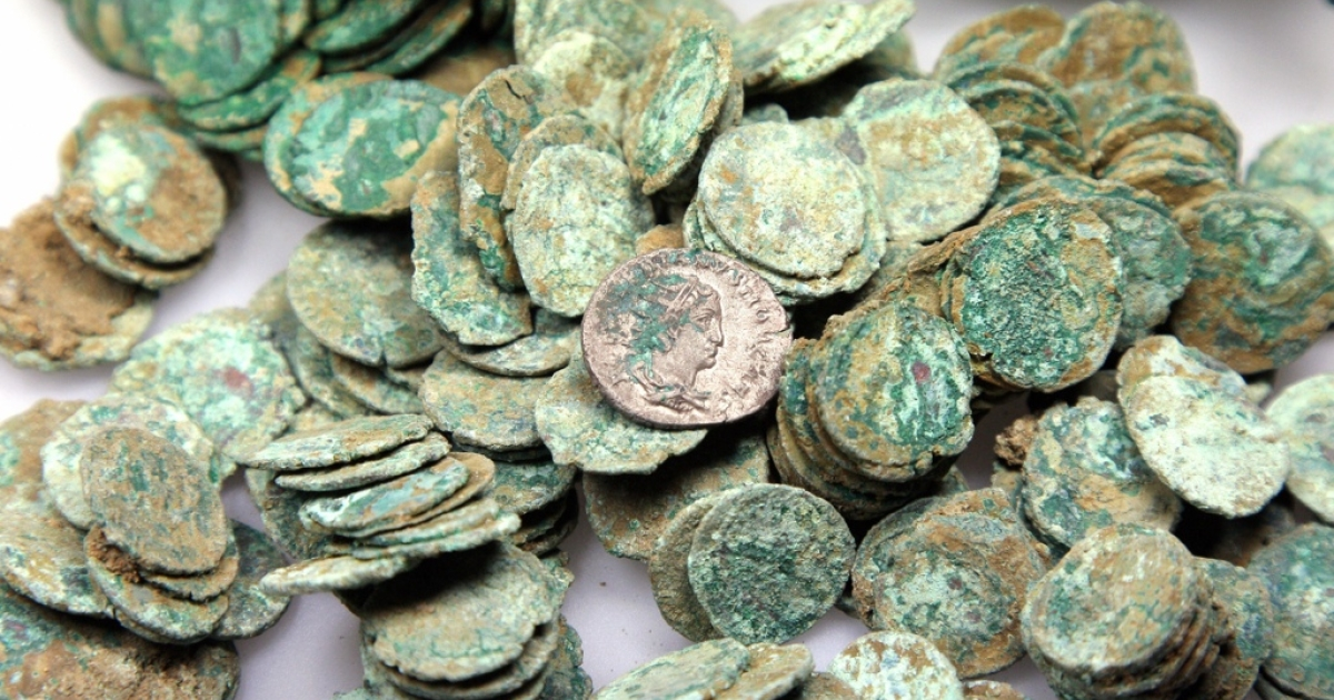 Copper coins from the second and third centuries found in a private garden in Paris.</p>