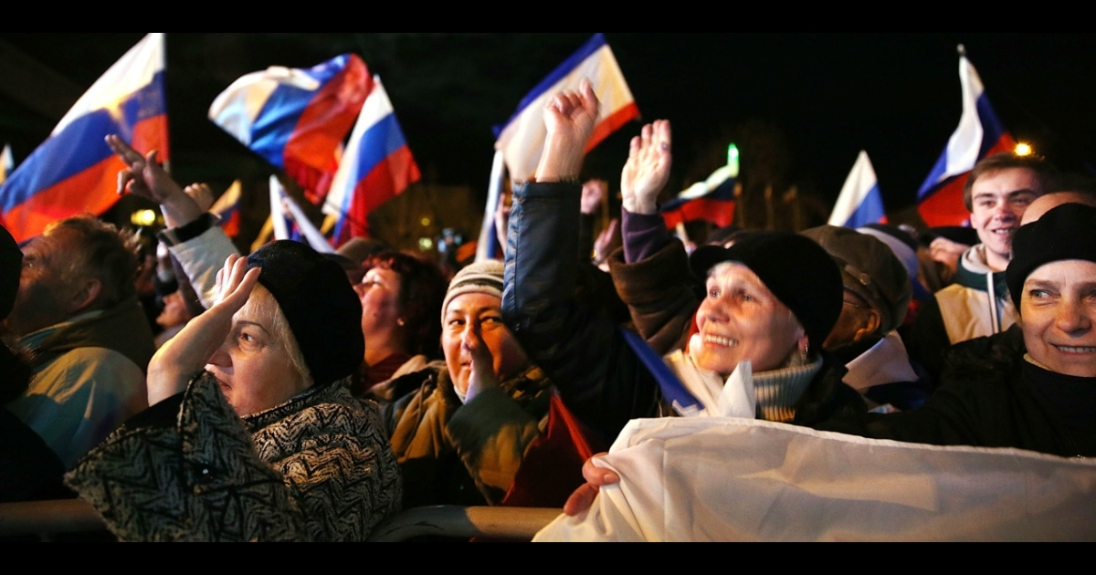 People in Crimea celebrate after voting to join Russia in a referendum organized by Crimea's pro-Russian authorities on March 16, 2014.</p>