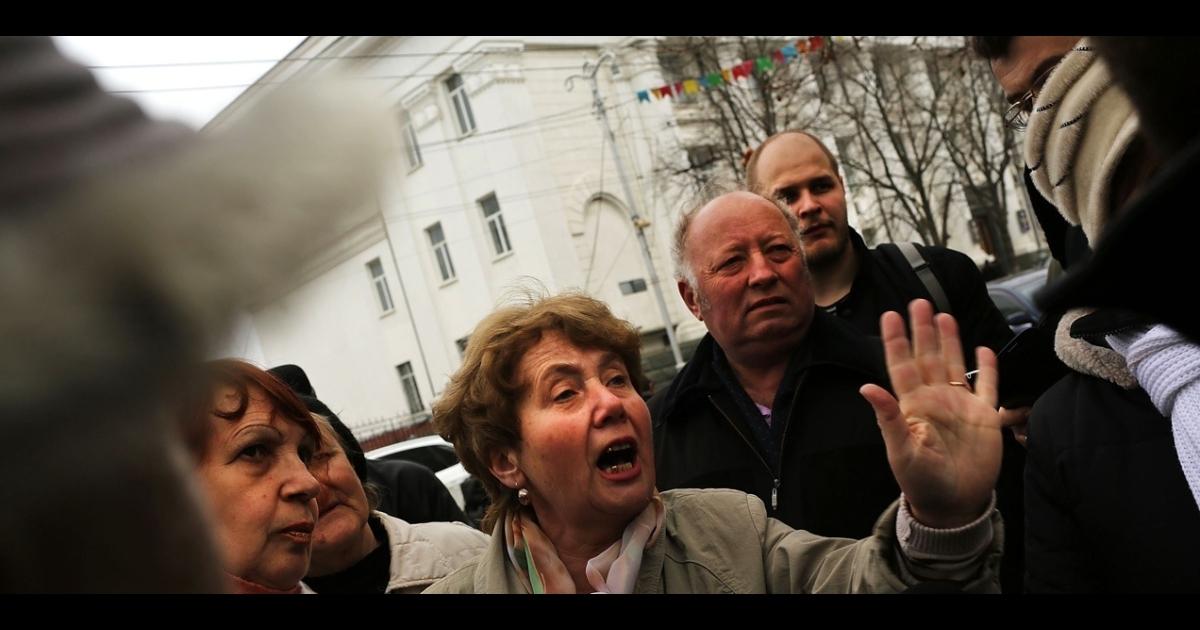 Pro-Russian residents fight with members of the media in Sevastopol harbor on March 7, 2014 in Sevastopol, Ukraine.</p>