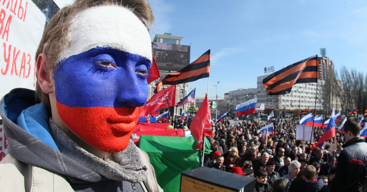A pro-Moscow activist with face painted in the colors of the Russian flag at a rally in Donetsk last weekend.</p>