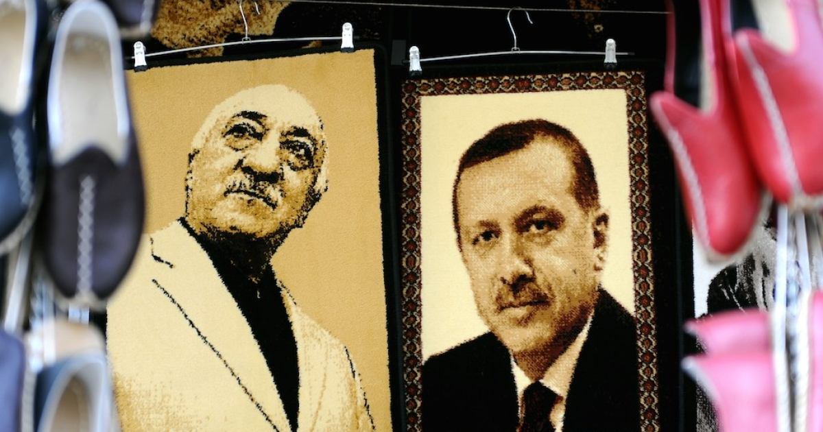 Embroidered images of US-based Turkish cleric Fethullah Gulen, left, and Turkish Prime Minister Recep Tayyip Erdogan are displayed in a market in Gaziantep near the Turkish-Syrian border on Jan. 17, 2014.</p>