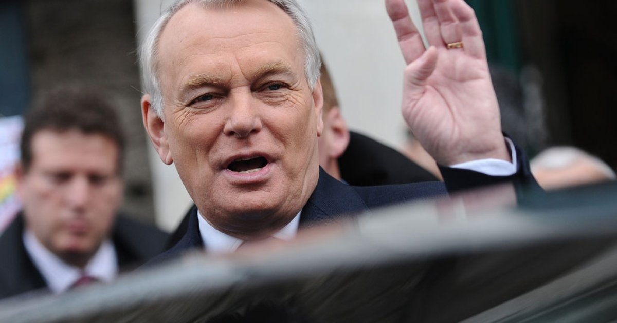 French Prime Minister and former Nantes mayor, Jean-Marc Ayrault, leaves a polling station after voting in the second round of the French municipal elections on March 30, 2014 in Nantes, western France.</p>