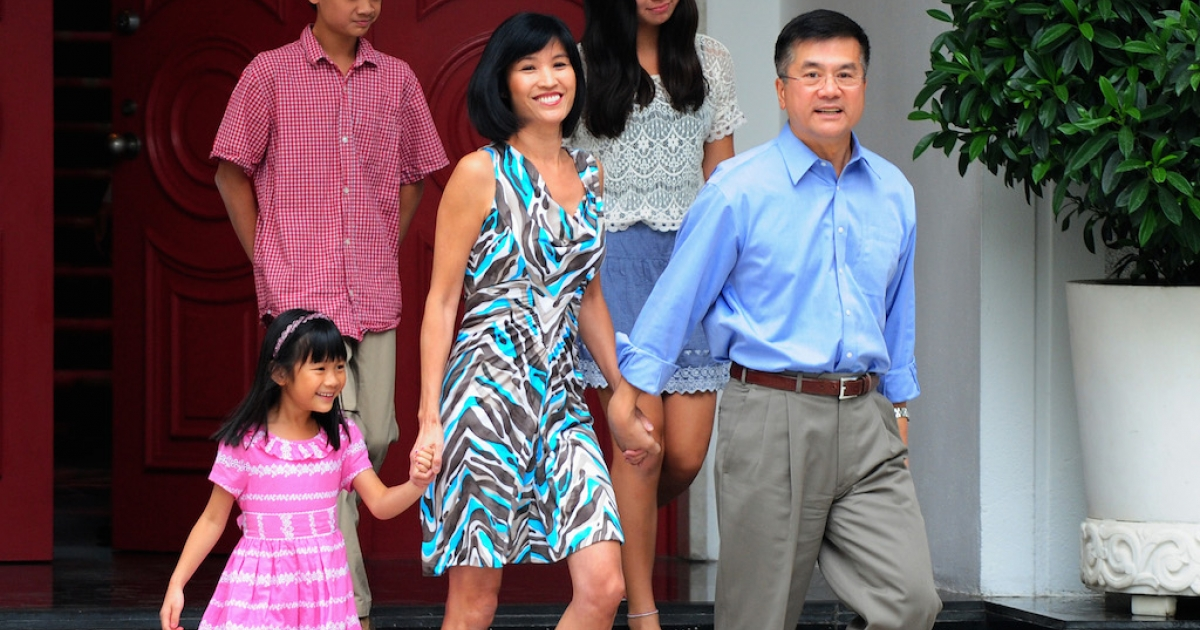 US ambassador Gary Locke and his family meet the press in China, in 2001. On his departure, a critique in China's official media called him a banana: yellow on the outside, with a white heart.</p>