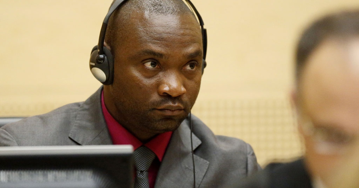 Congolese national and former militia chief Germain Katanga looks on during the closing statements in his and fellow former militia chief Mathieu Ngudjolo Chui's trial, at the International Criminal Court (ICC) in The Hague on May 15, 2012.</p>