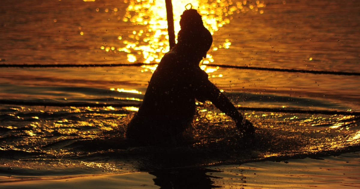 An Indian Naga Sadhu takes a holy dip at Sangam on the auspicious occasion of Basant Panchami during the annual traditional fair Magh Mela in Allahabad on February 4, 2014.</p>