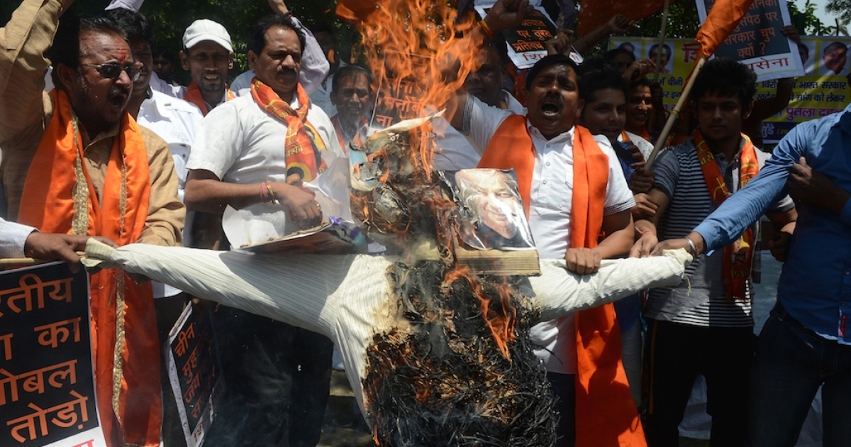 Right-wing Hindu activists from Shiva Sena burn an effigy of Indian Prime Minister Manmohan Singh as they shout anti-China slogans during a protest against an incursion by Chinese troops in May 2013. In elections that begin in April, the right wing BJP appears likely to win control of India.</p>