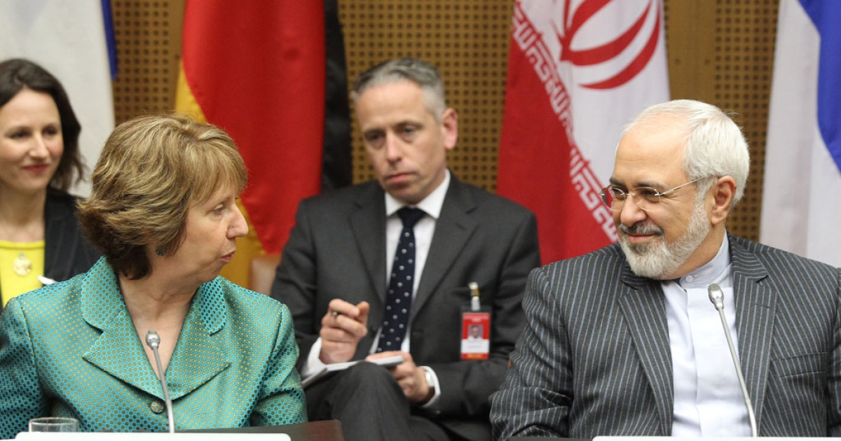 Catherine Ashton (L), High Representative of the Union of Foreign Affairs and Security Policy for the European Union, and Iranian Foreign Minister Mohammad Javad Zarif attend the first day of the second round of P5+1 talks with Iran at the UN headquarters in Vienna, Austria on March 18, 2014.</p>