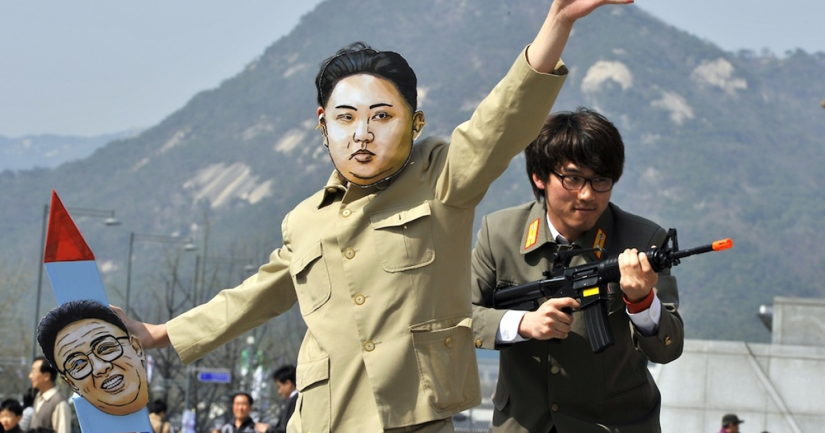 A South Korean activist wears a mask of Kim Jong-Un during a rally denouncing North Korea's rocket launch and the three-generational dictatorship, in Seoul on April 15, 2012. The 2014 war games, which began last week, are already provoking antics from North Korea.</p>
