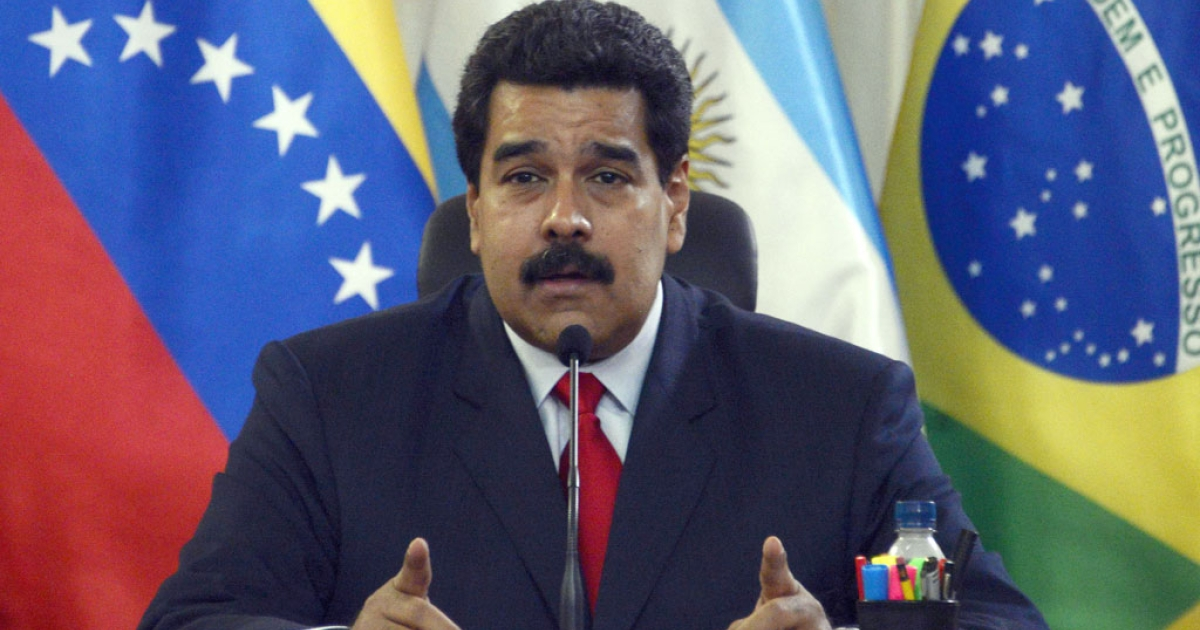 Venezuelan President Nicolas Maduro delivers a speech during an UNASUR's foreign ministers meeting at the Miraflores Presidential Palace in Caracas on March 25, 2014.</p>
