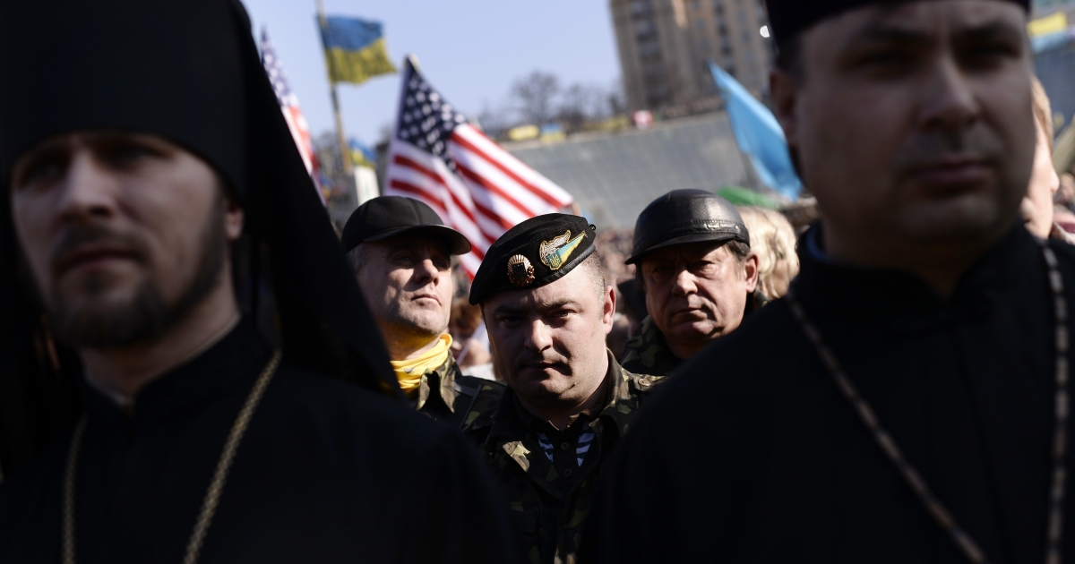 Volunteers and clerics commemorate the 200th anniversary of Ukraine's national poet Taras Shevchenko on the Maidan last weekend. There's mounting anger over the lack of action by the Ukrainian government and its Western allies to halt Russia's tightening grip on Crimea.</p>