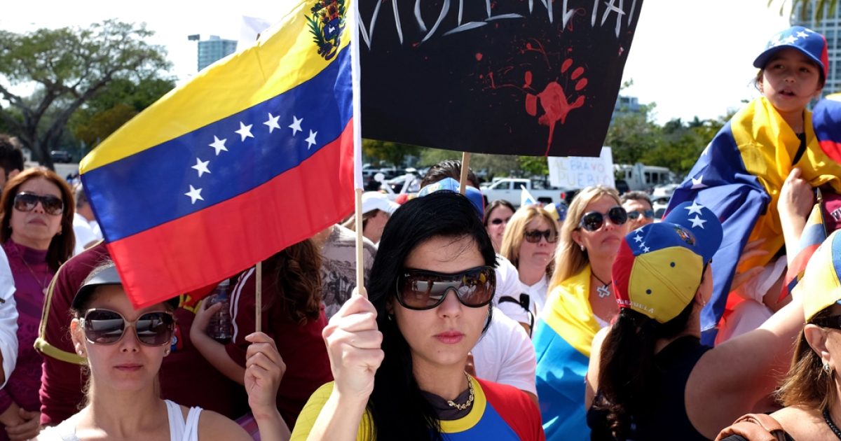 Venezuelans show their support for anti-government protests in Venezuela on March 1, 2014 in Miami, Florida. In Venezuela, protests over the past couple of weeks have resulted in violence as government opponents and supporters have faced off in the streets.</p>