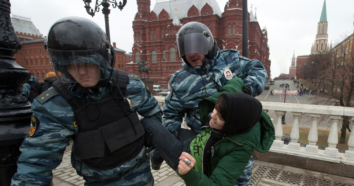 Russian police detain an anti-war protester near the Kremlin during on Sunday.</p>