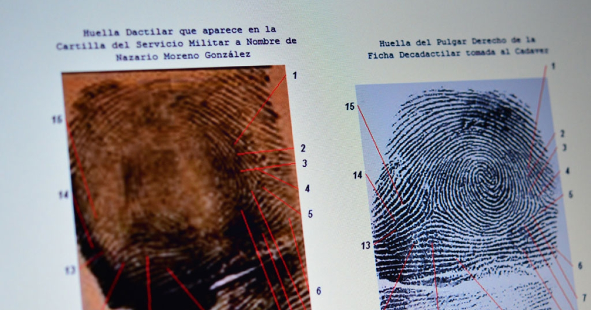 Picture of a screen with a comparison of the alleged fingerprints of Nazario Moreno aka 'El Chayo,' the leader of 'Los Caballeros Templarios' drug cartel, during a press conference at the Interior Ministry building on March 9, 2014 in Mexico City.</p>