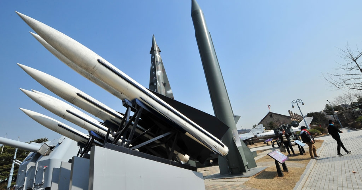 Visitors walk past replicas of a North Korean Scud-B missile (R) and South Korean Hawk surface-to-air missiles (L) at the Korean War Memorial in Seoul on March 3, 2014.</p>