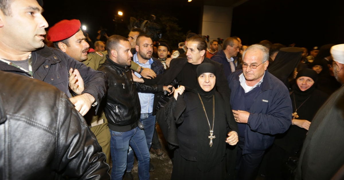 Blajaa Sayyaf (C), head of the nun monastery Maalula and other kidnapped nuns arrive at Jdeidet Yabus, on the Syrian side of the border with Lebanon after an arduous nine-hour journey that took them from Yabrud into Lebanon, and then back into Syria on March 10, 2014.</p>