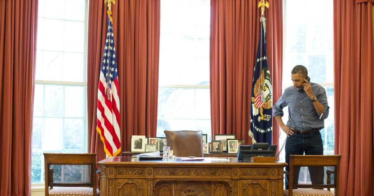 President Barack Obama talks on the phone in the Oval Office with Russian President Vladimir Putin about the situation in Ukraine, March 1.</p>