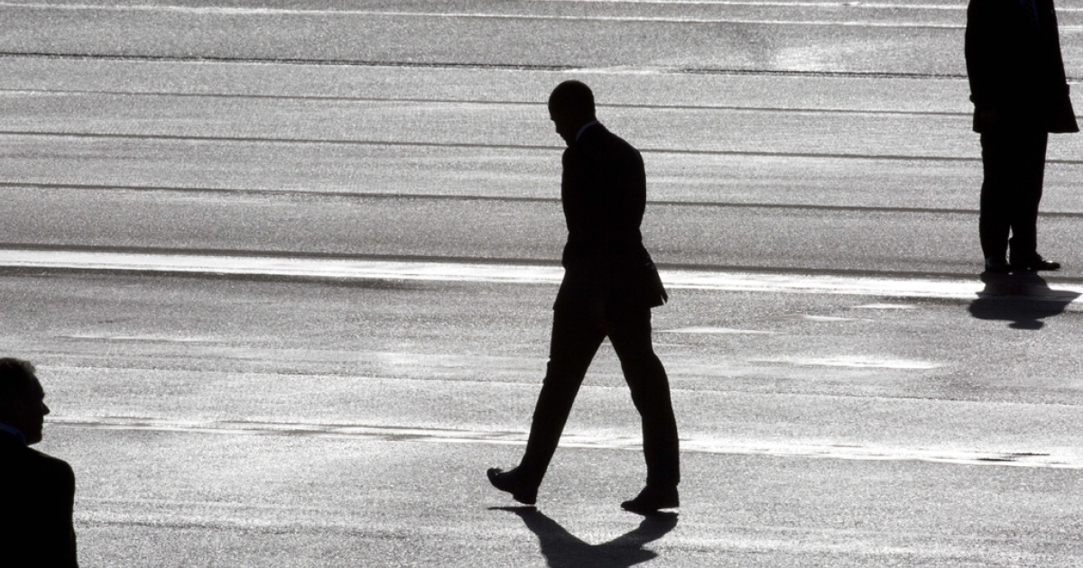 President Barack Obama (C) and two secret service agents are silhouetted as he walks towards Marine One helicopter as they arrive at Schiphol Amsterdam Airport ahead of the 2014 Nuclear Security Summit  on March 24, 2014, in Amsterdam, Netherlands.</p>