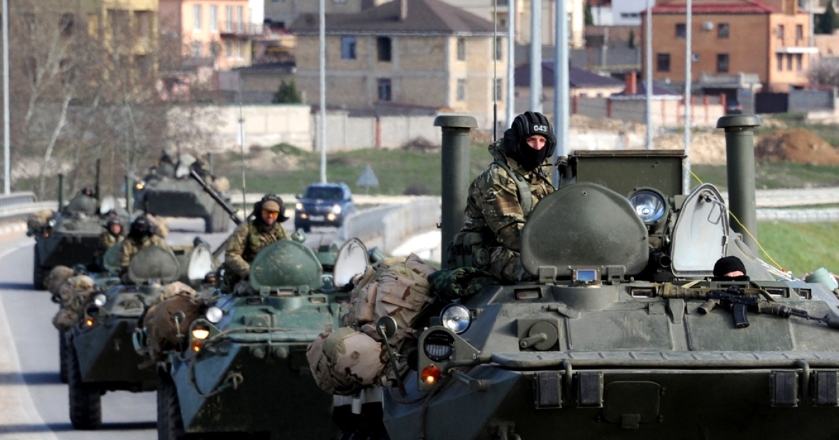 Russian armored vehicles drive on the road between Simferopol and Sevastopol on March 17, 2014.</p>