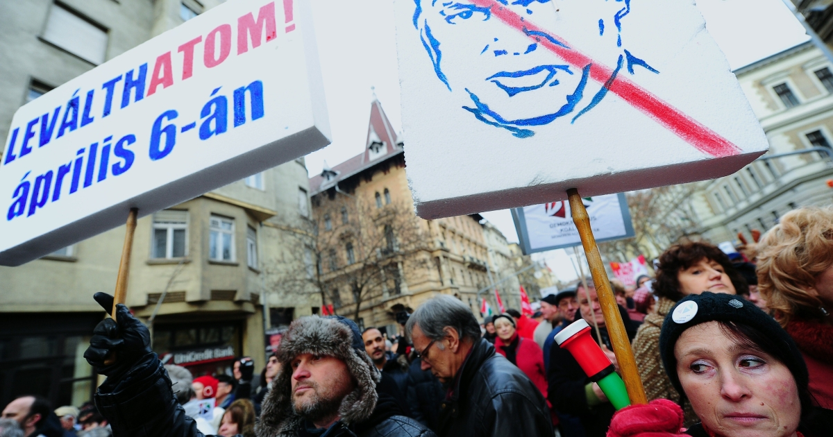 Eminence grise: Hungarians protests against Viktor Orban ahead of the elections.</p>