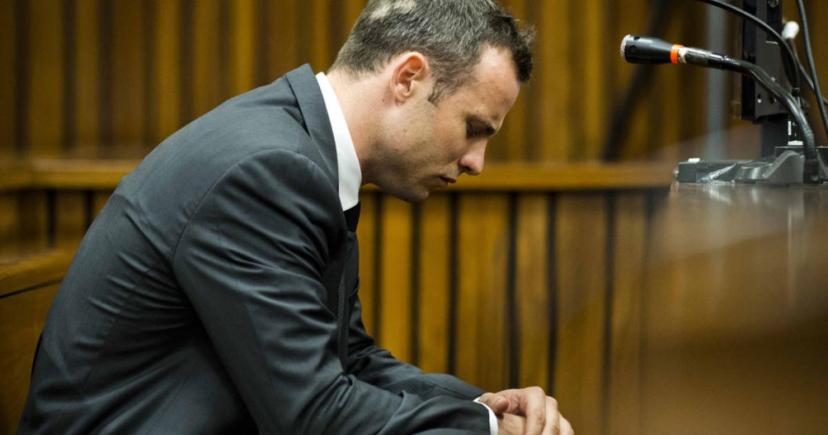 South African paralympic athlete Oscar Pistorius sits on the fifth day of his trial for the 2013 murder of his girlfriend, on March 7, 2014 at the high court in Pretoria.</p>