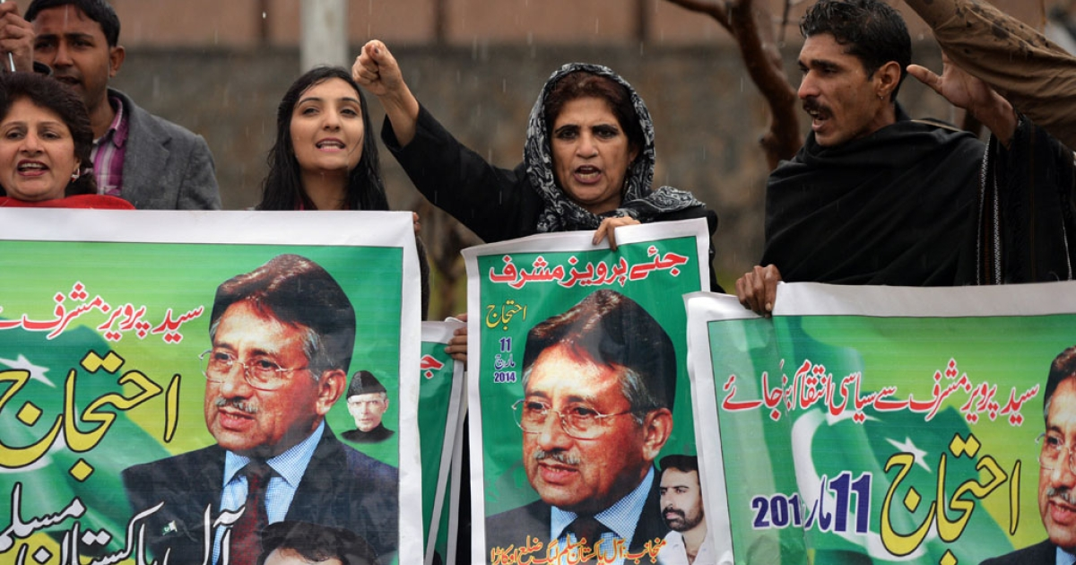 Pakistani supporter of former military ruler Pervez Musharraf shout slogans as they hold banners with images of Musharraf outside a special court set up to try Musharraf during a hearing in Islamabad on March 11, 2014.</p>