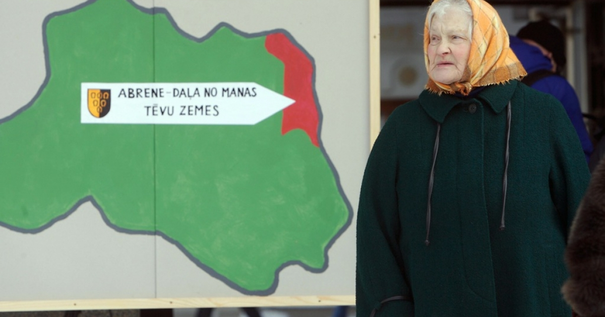 Riga, LATVIA: (FILES) A recent, undated file photo shows a woman protesting in Riga against a Latvian government project to sign Latvia-Russia border treaty. Placard reads: