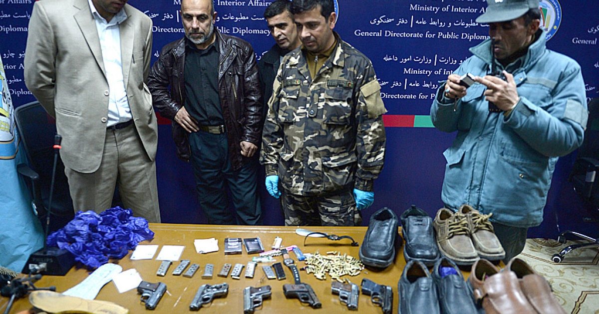 Afghan security officials display weapons and items used by gunmen who attacked the Serena hotel in Kabul on March 20, 2014. At least nine civilians including an Agence France-Presse reporter, two of his children and four foreigners were killed in a Taliban attack on the luxury hotel in Kabul, officials said a day later.</p>