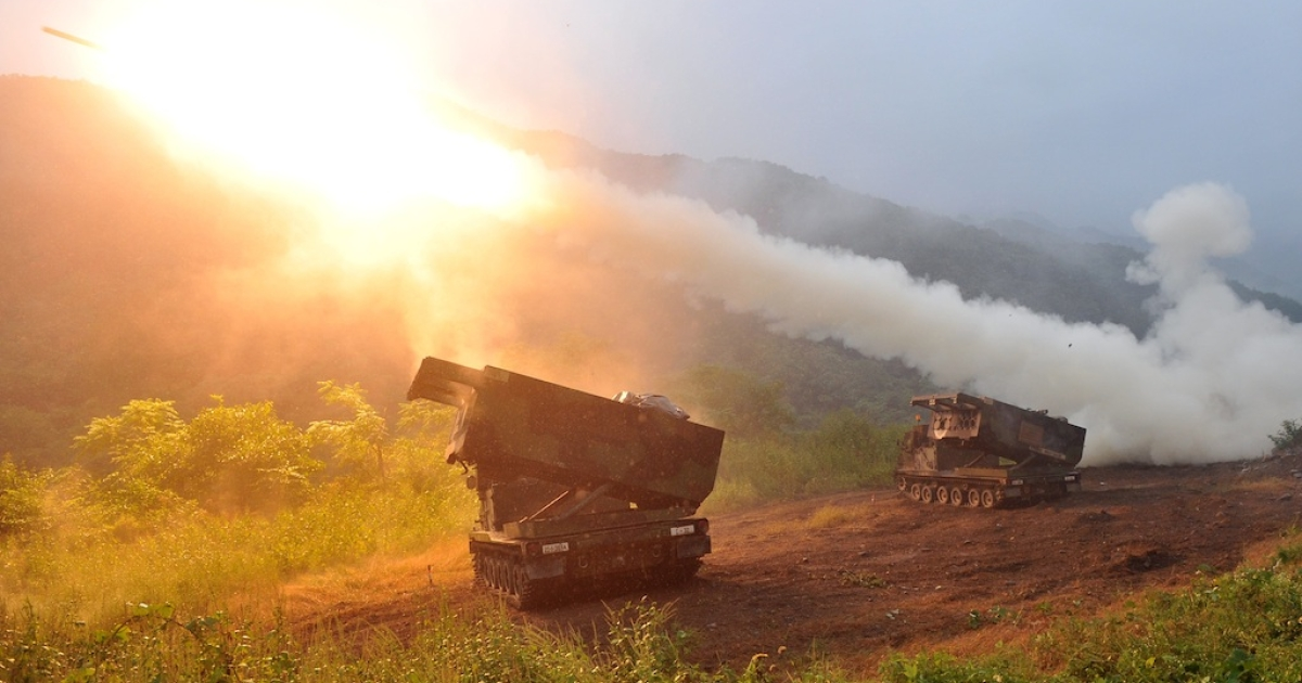 A US Multiple Launch Rocket System fires rockets during a training exercise in the South Korean border county of Cheorwon on September 13, 2012. In apparent violation of UN resolutions, North Korea test fired two medium-range missiles today, according to Seoul. The annual US-South Korea military exercises are among the irritants that may have sparked the launch.</p>