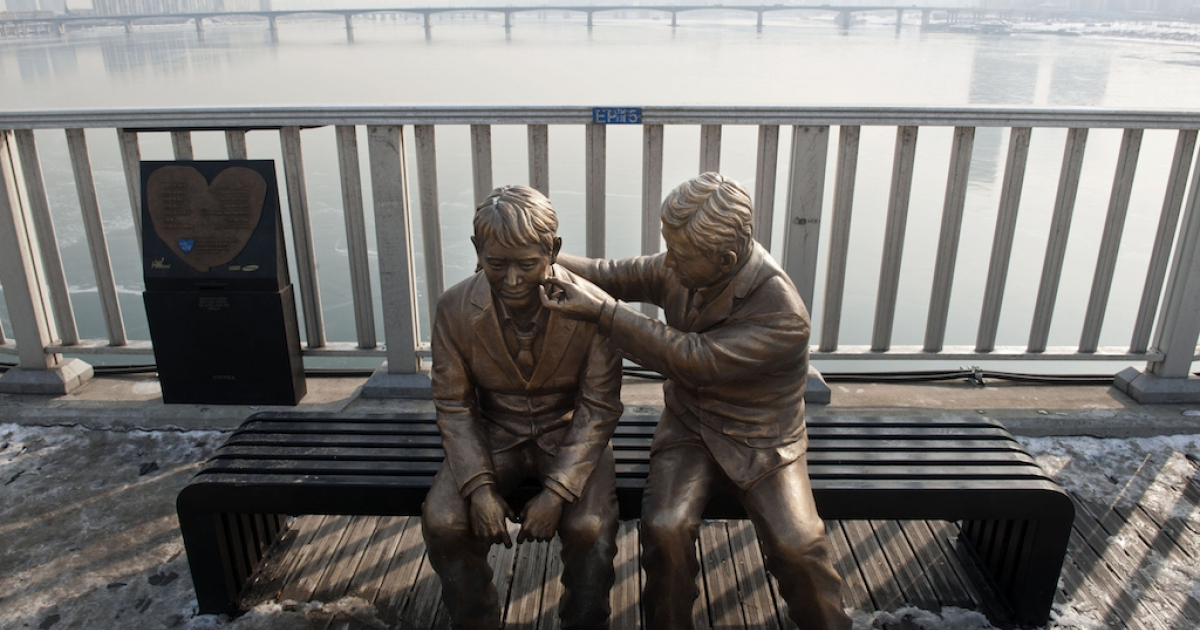 South Korea's government installed this statue of a man comforting another person, in an attempt to address the many suicides at the Mapo Bridge. Two recent high profile suicides have shocked the nation.</p>