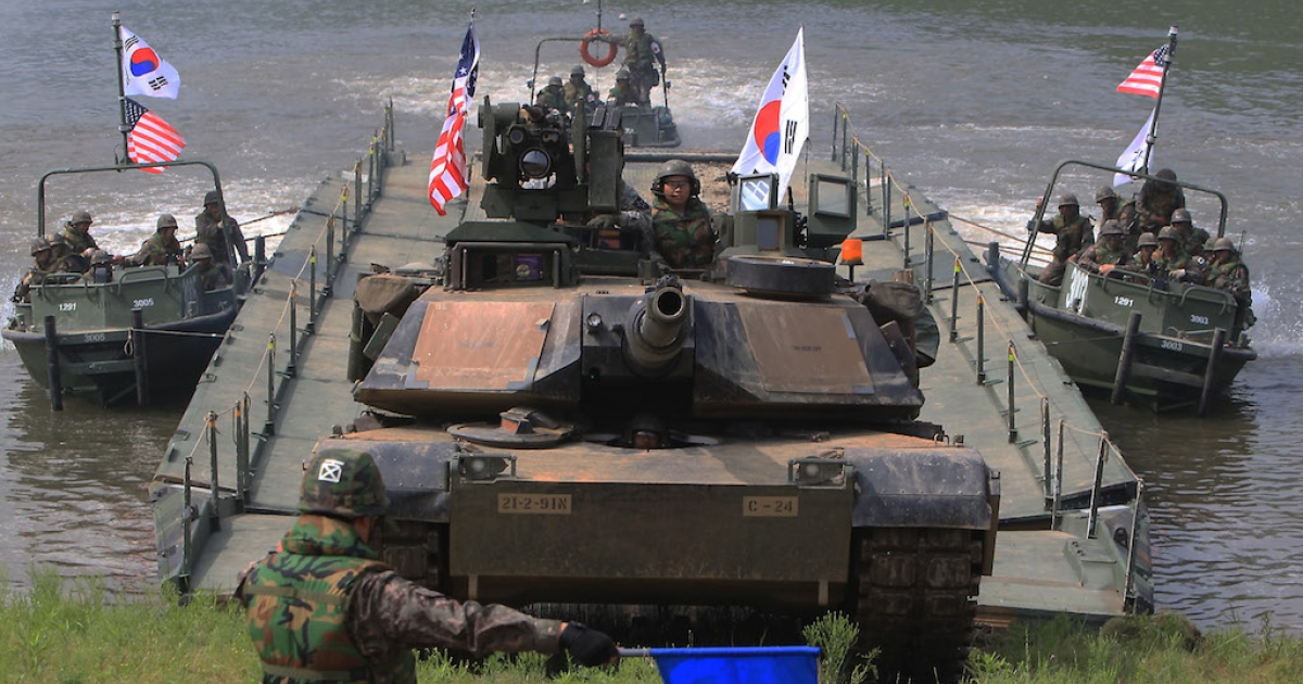 US and South Korean soldiers participate in a river crossing exercise on May 30, 2013 in South Korea. Are the exercises worth the trouble?</p>